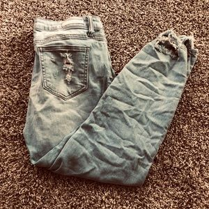 High-rise distressed light wash skinny jeans